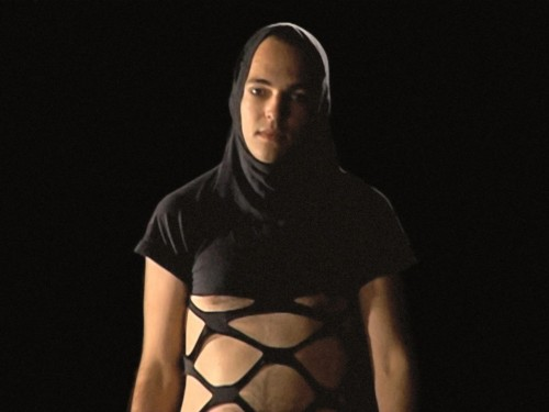 Sharif Waked, Chic Point: Fashion for Israeli Checkpoints(2003), Still from video documentation of performance ©Sharif Waked and Gallery One, Ramallah