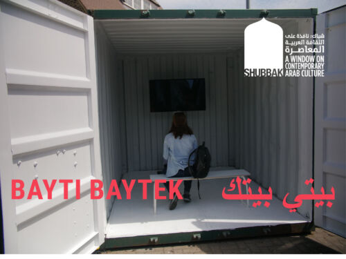 A woman sitting in a shipping container