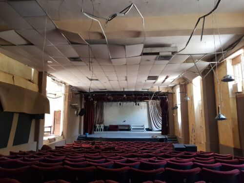A colour image of a damaged theatre auditorium in Beirut