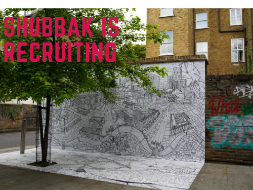 A picture of a tree against a wall which features a black and white mural and the words Shubbak is recruiting across the top