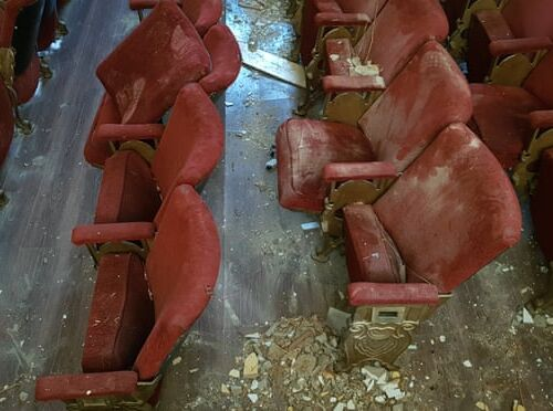 A picture of red velvet theatre seats covered in rubble following the explosion in the port of Beirut on 4 August 2020.