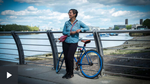 Portrait of a woman on a bridge with a bike