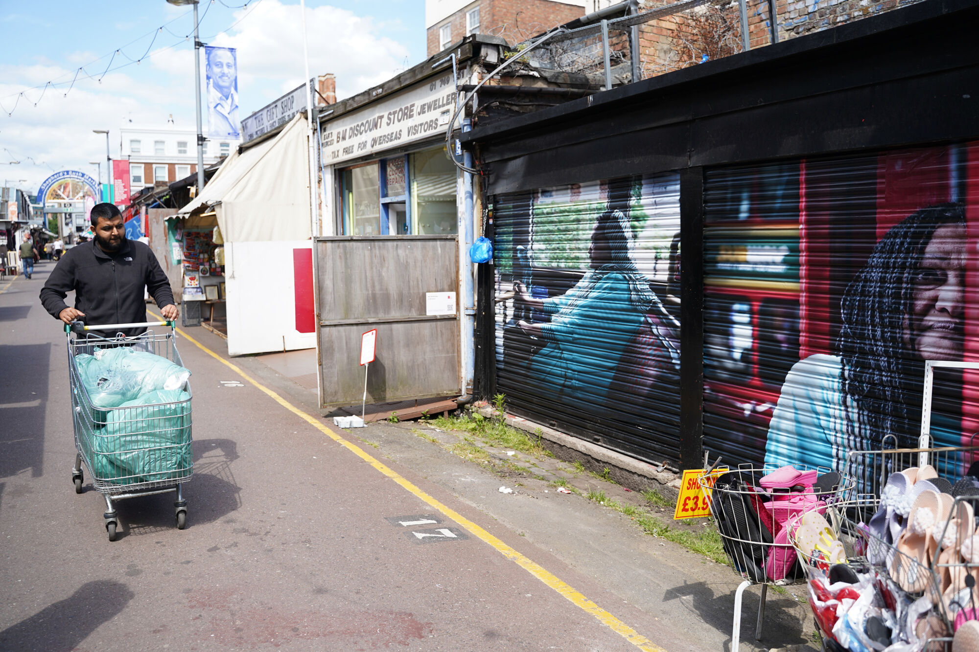 Large scale mural installed in a busy market