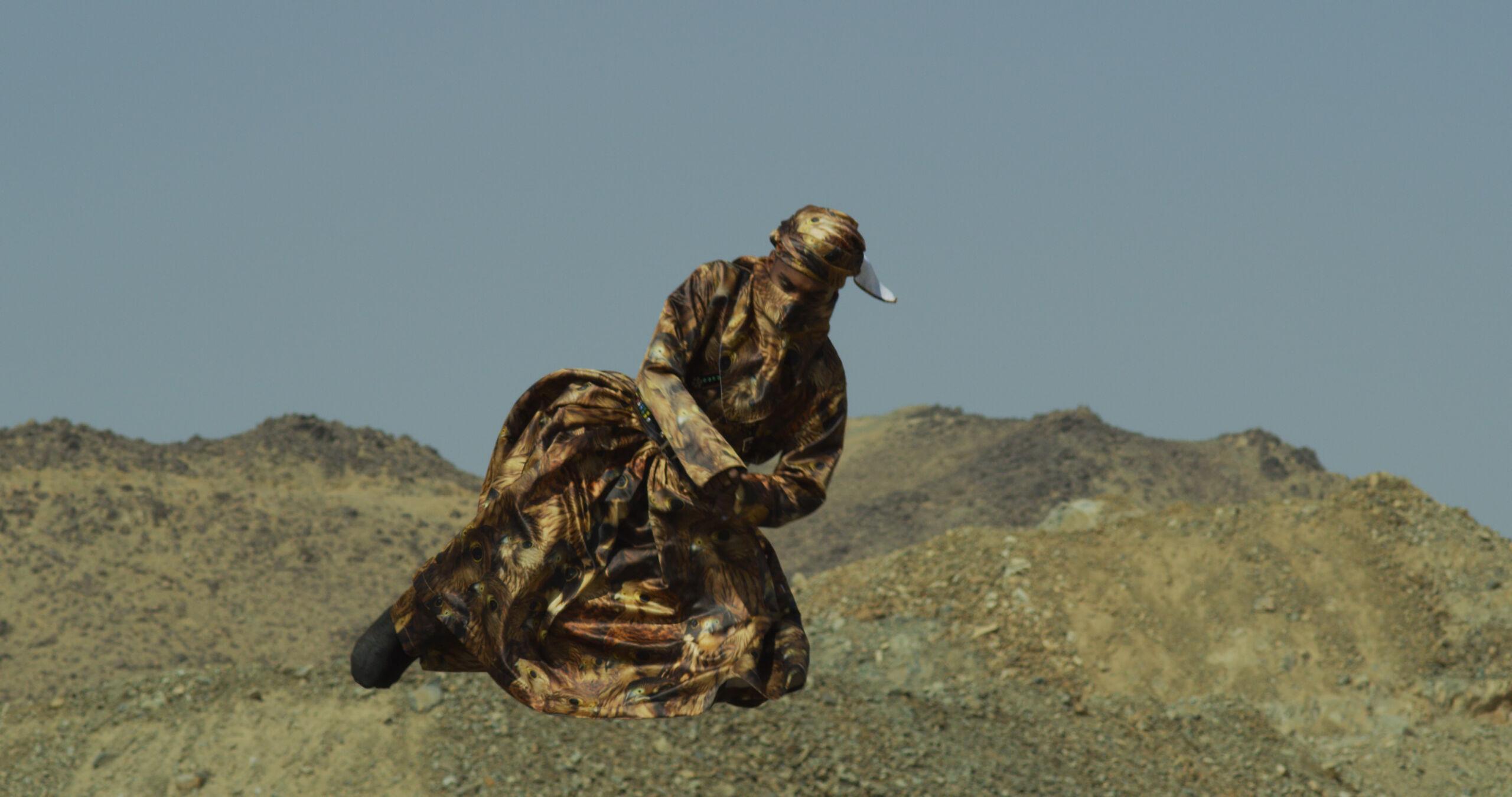 elaborately dressed figure in the desert