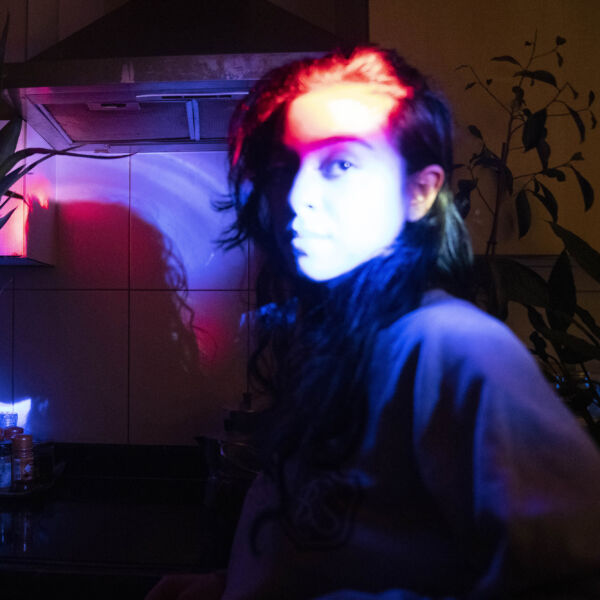 spotlit DJ portrait