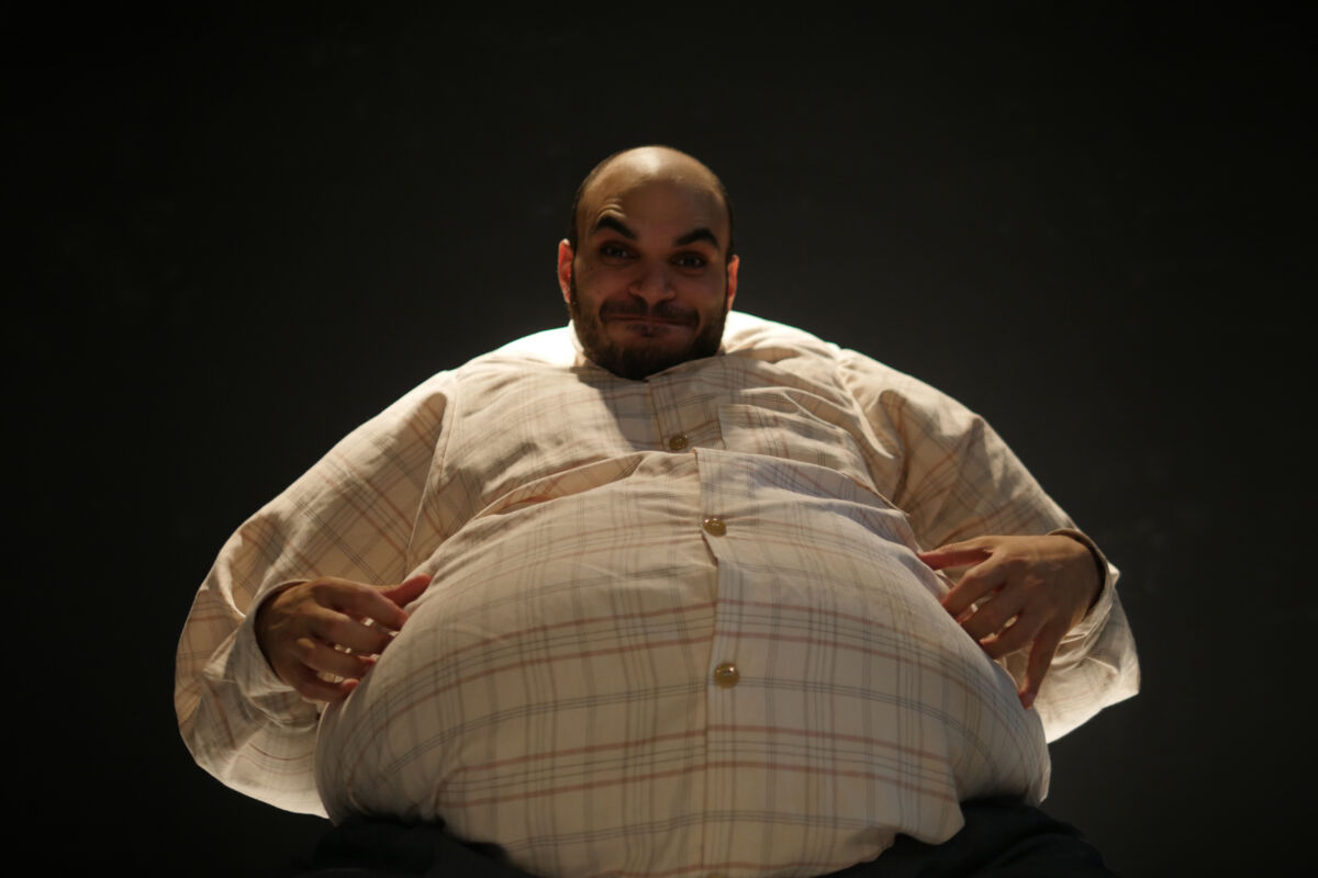 man performing in a fat suit on stage