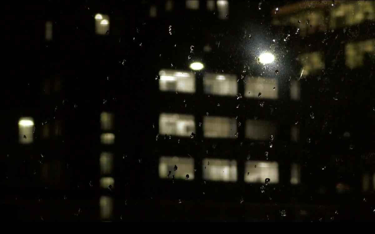 flats at night through a window