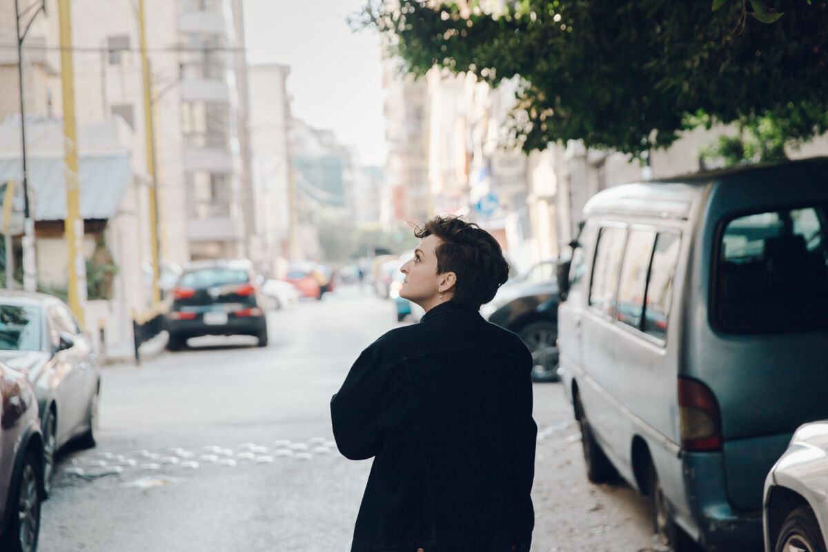woman walks down a street