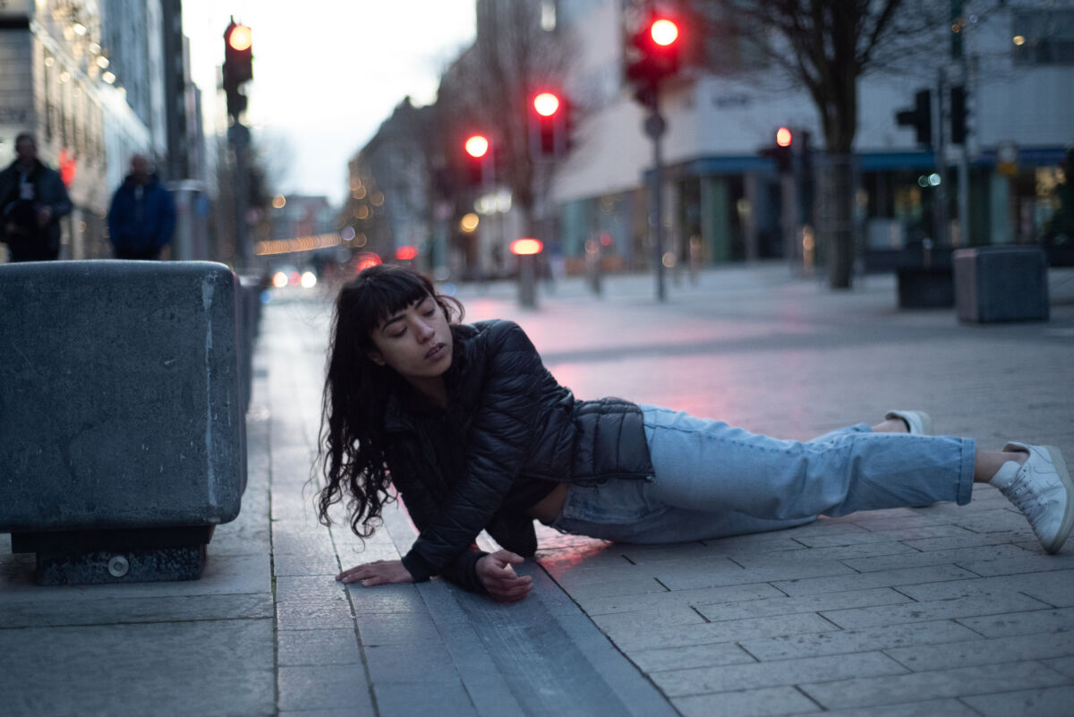 dancer performing on a street pavement