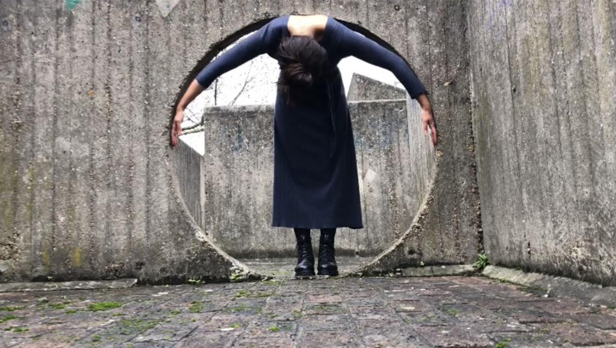 Dancer moulds her body to a circular concrete space