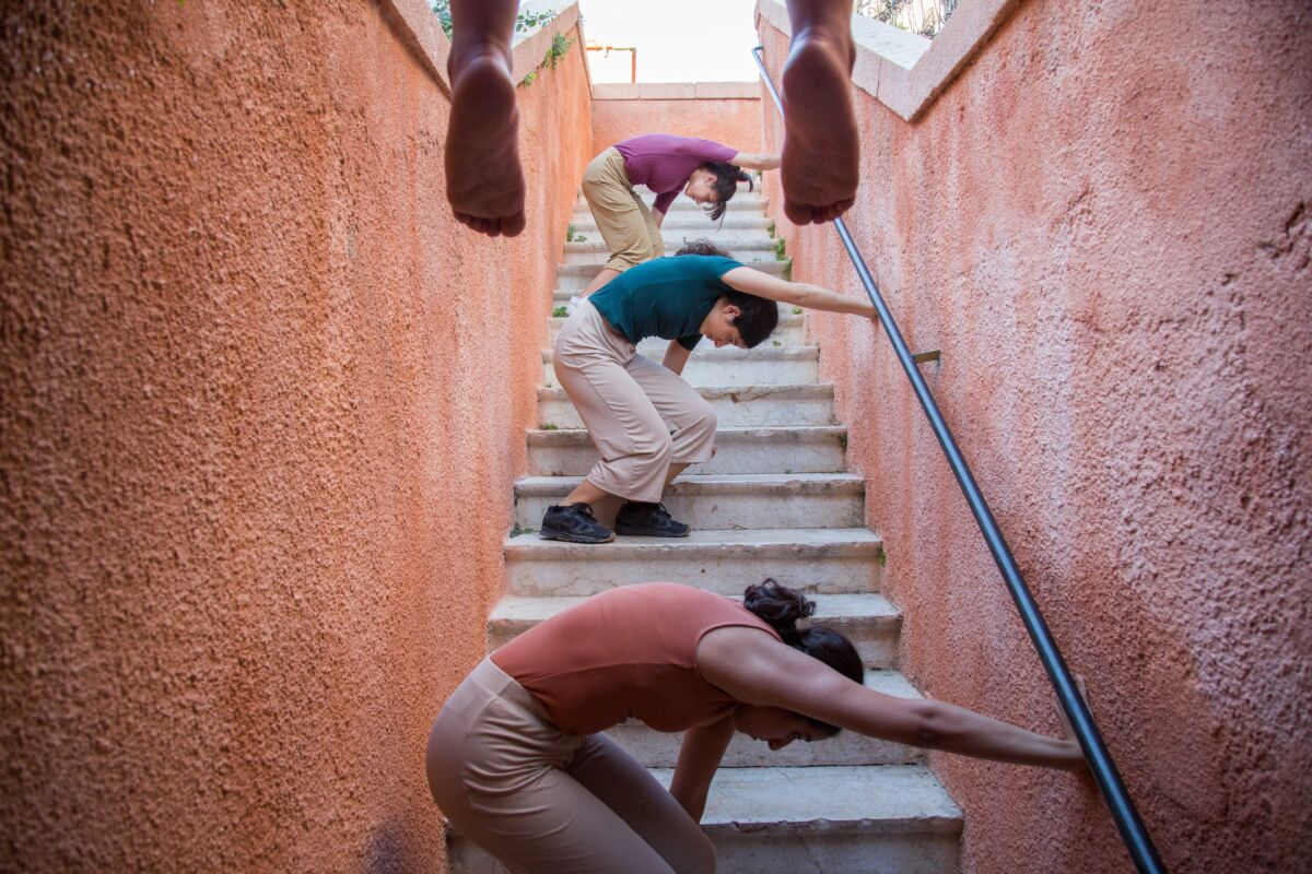 dancers perform on an outdoor stairwell