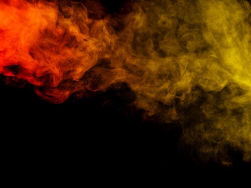 Image of coloured smoke on a dark background