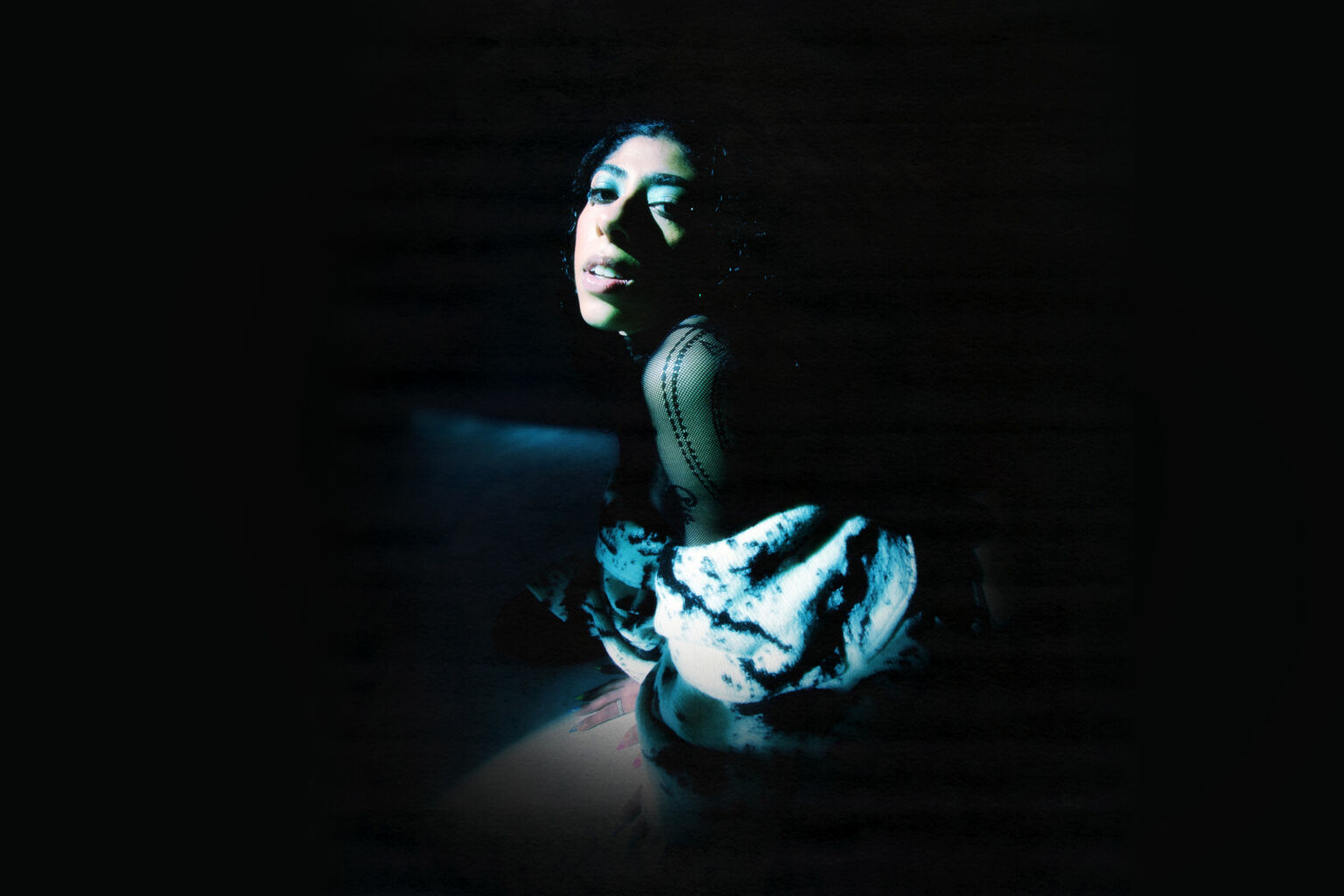 Young woman in dramatic lighting