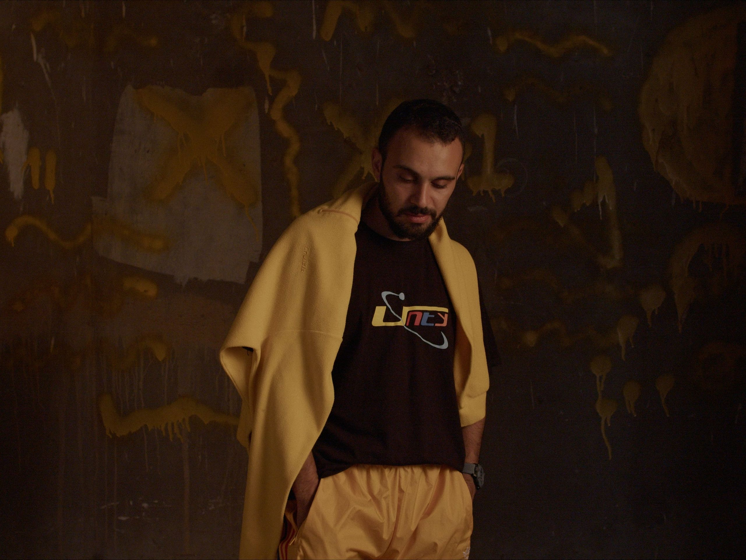A man in yellow trackpants and sweatshirt