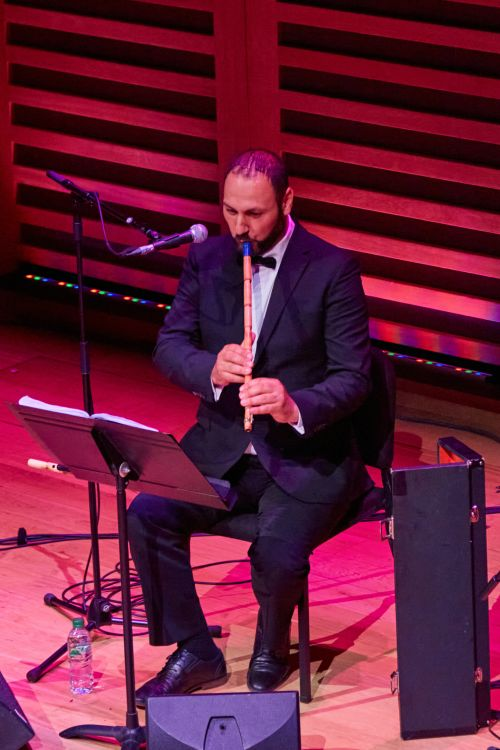 A musician playing a wind instrument.